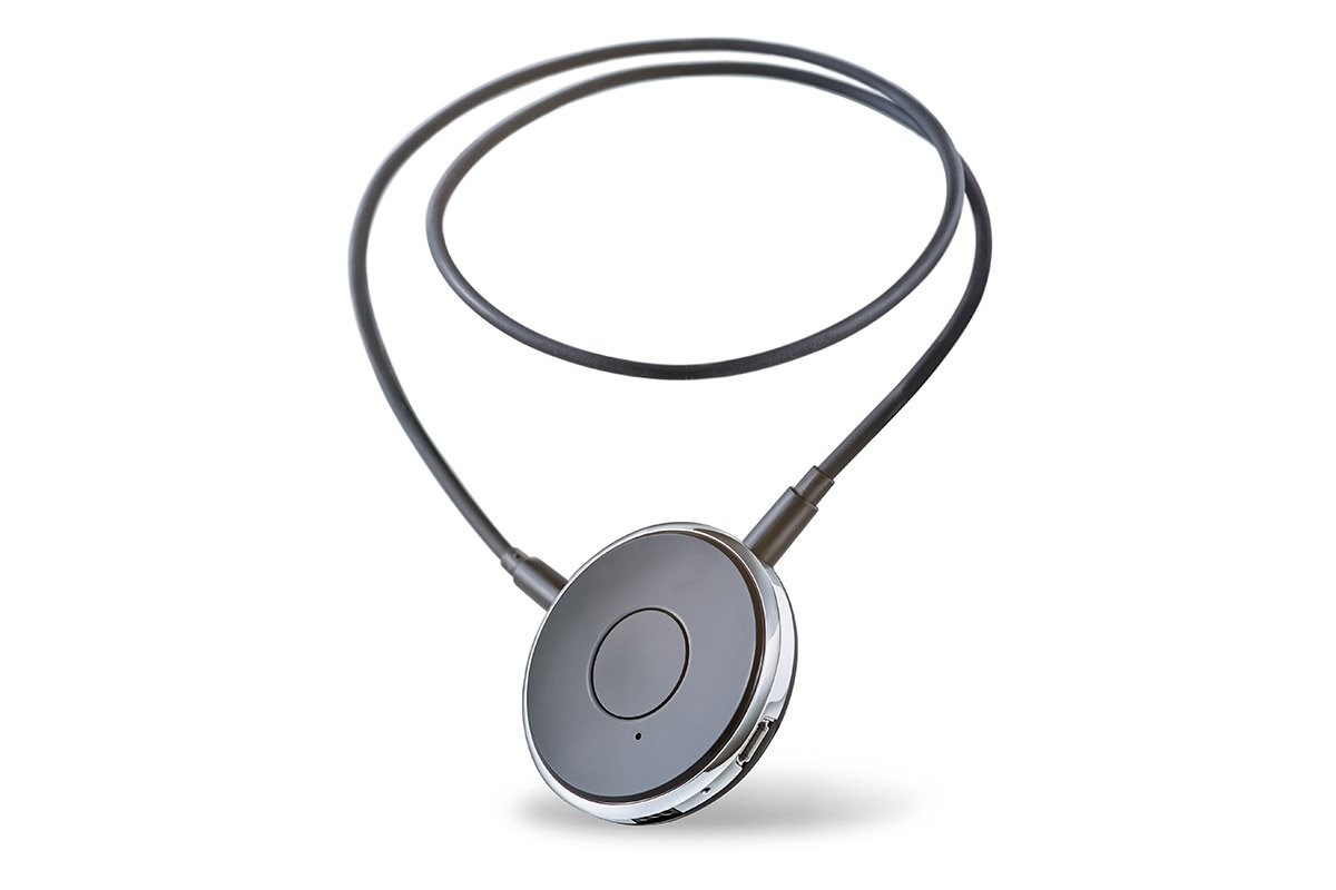 Hands-free Bluetooth remote for hearing aids. Small round disc on a lanyard.