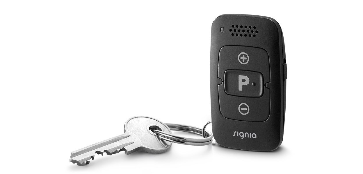 A key-fob that is a wireless remote for hearing aids.