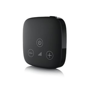 small black coaster-sized device that wirelessly connects hearing instruments to the TV or other media devices.